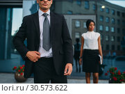Bodyguard in suit and sunglasses, female VIP. Стоковое фото, фотограф Tryapitsyn Sergiy / Фотобанк Лори