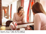 Купить «Young woman in pajama in front of the mirror», фото № 30573802, снято 13 августа 2018 г. (c) Tryapitsyn Sergiy / Фотобанк Лори