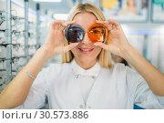 Купить «Woman applies lenses of different colors to eyes», фото № 30573886, снято 23 августа 2018 г. (c) Tryapitsyn Sergiy / Фотобанк Лори