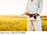 Купить «Male karate fighter in kimono with black belt», фото № 30573990, снято 26 августа 2018 г. (c) Tryapitsyn Sergiy / Фотобанк Лори