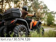 Rider in helmet on quad bike, front view, closeup. Стоковое фото, фотограф Tryapitsyn Sergiy / Фотобанк Лори