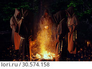 Medieval monks praying against a fire in the night. Стоковое фото, фотограф Tryapitsyn Sergiy / Фотобанк Лори
