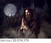 Medieval monk praying against castle and full moon. Стоковое фото, фотограф Tryapitsyn Sergiy / Фотобанк Лори
