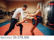 Купить «Female fighter hiding from a knife strike», фото № 30574306, снято 9 сентября 2018 г. (c) Tryapitsyn Sergiy / Фотобанк Лори