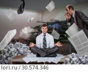 Купить «Businessman meditates among piles of reports», фото № 30574346, снято 8 сентября 2011 г. (c) Tryapitsyn Sergiy / Фотобанк Лори