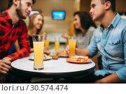 Friends in bowling club, game board on background. Стоковое фото, фотограф Tryapitsyn Sergiy / Фотобанк Лори