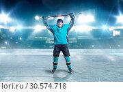 Купить «Hockey player raised his hands up, winner», фото № 30574718, снято 20 апреля 2017 г. (c) Tryapitsyn Sergiy / Фотобанк Лори