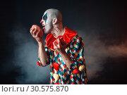 Купить «Mad bloody clown licks human brain», фото № 30575870, снято 7 декабря 2018 г. (c) Tryapitsyn Sergiy / Фотобанк Лори