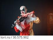 Купить «Bloody clown plays the violin with a human hand», фото № 30575902, снято 7 декабря 2018 г. (c) Tryapitsyn Sergiy / Фотобанк Лори