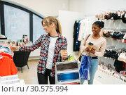 Купить «Black and white women shopping, ladies lingerie», фото № 30575994, снято 8 декабря 2018 г. (c) Tryapitsyn Sergiy / Фотобанк Лори