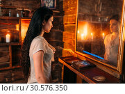 Young woman at the mirror on spiritual seance. Стоковое фото, фотограф Tryapitsyn Sergiy / Фотобанк Лори