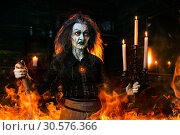 Купить «Scary witch with a cane at the mirror and candles», фото № 30576366, снято 29 января 2019 г. (c) Tryapitsyn Sergiy / Фотобанк Лори