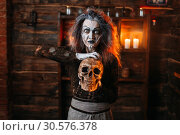 Купить «Witch reads the spell, ritual with human skull», фото № 30576378, снято 29 января 2019 г. (c) Tryapitsyn Sergiy / Фотобанк Лори