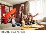Friends cheer for favorite team, football fans. Стоковое фото, фотограф Tryapitsyn Sergiy / Фотобанк Лори