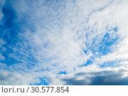 Купить «Blue sky background with white clouds in the sky lit by sunlight», фото № 30577854, снято 25 апреля 2018 г. (c) Зезелина Марина / Фотобанк Лори