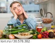 Купить «Upset woman sitting at home kitchen», фото № 30578382, снято 5 июня 2020 г. (c) Яков Филимонов / Фотобанк Лори
