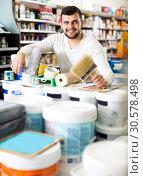 Male customer purchasing tools for house improvements. Стоковое фото, фотограф Яков Филимонов / Фотобанк Лори