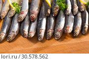 Купить «Salted European anchovies with lemon and parsley», фото № 30578562, снято 20 апреля 2019 г. (c) Яков Филимонов / Фотобанк Лори