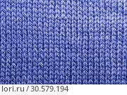 Купить «Needlework, hobbies, knitting. Background textile fabric with a knitted texture wool blue», фото № 30579194, снято 31 марта 2019 г. (c) Светлана Евграфова / Фотобанк Лори