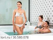 Купить «Three friends relaxing enjoying jacuzzi hot tub bubble bath», фото № 30580078, снято 12 июня 2017 г. (c) Яков Филимонов / Фотобанк Лори
