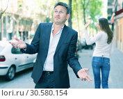 Купить «Disappointed man in quarrel with girlfriend», фото № 30580154, снято 11 апреля 2017 г. (c) Яков Филимонов / Фотобанк Лори