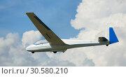Купить «Airframe hovering highly in the sky on a background of clouds», фото № 30580210, снято 20 мая 2018 г. (c) Яков Филимонов / Фотобанк Лори