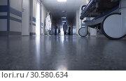 Купить «Доктор идет по коридору клиники», видеоролик № 30580634, снято 14 апреля 2019 г. (c) Beerkoff / Фотобанк Лори