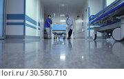 Купить «Транспортировка пациента в больнице», видеоролик № 30580710, снято 15 апреля 2019 г. (c) Beerkoff / Фотобанк Лори