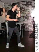 Купить «Jimi Blue showcase to promote his upcoming EP '3LUE' and song 'Schuetteln' at Hard Rock Cafe at Kurfuerstendamm. Featuring: Jimi Blue Ochsenknecht Where...», фото № 30592610, снято 12 июня 2017 г. (c) age Fotostock / Фотобанк Лори
