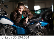 Купить «Beautiful motorcycle brunette woman with classic motorcycle, brown lather jacket», фото № 30594634, снято 24 февраля 2019 г. (c) Кекяляйнен Андрей / Фотобанк Лори