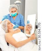 Купить «Woman getting ready for plastic surgery», фото № 30594770, снято 14 марта 2019 г. (c) Яков Филимонов / Фотобанк Лори
