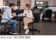 Купить «Girl and young man talking in coworking space», фото № 30594886, снято 16 марта 2019 г. (c) Яков Филимонов / Фотобанк Лори