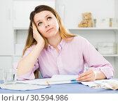 Купить «Positive young girl preparing agreement papers», фото № 30594986, снято 13 марта 2017 г. (c) Яков Филимонов / Фотобанк Лори