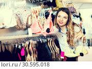 Купить «Customer woman in lingerie shop», фото № 30595018, снято 20 марта 2017 г. (c) Яков Филимонов / Фотобанк Лори