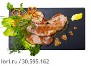 Купить «Cooked fried pork meat with different herbs served on black plate», фото № 30595162, снято 20 апреля 2019 г. (c) Яков Филимонов / Фотобанк Лори