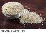 Купить «Glass bowl with quinoa on wooden background», фото № 30595186, снято 20 апреля 2019 г. (c) Яков Филимонов / Фотобанк Лори