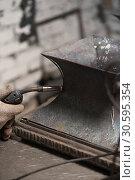 Купить «Close up of soldering of metal plate in workshop», фото № 30595354, снято 24 декабря 2018 г. (c) Pavel Biryukov / Фотобанк Лори
