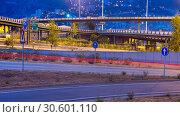 Купить «View of city highway in dusk with trace of blurred headlights», фото № 30601110, снято 20 июля 2017 г. (c) Яков Филимонов / Фотобанк Лори