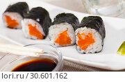 Купить «Sushi maki set with salmon», фото № 30601162, снято 20 апреля 2019 г. (c) Яков Филимонов / Фотобанк Лори