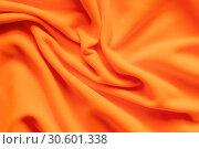 Купить «Texture of vibrant orange fleece,», фото № 30601338, снято 5 апреля 2019 г. (c) EugeneSergeev / Фотобанк Лори