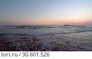 Купить «Sea wave slowly swims ashore at sunset - Indian Ocean, Hikkaduwa; Sri Lanka», видеоролик № 30601526, снято 26 марта 2019 г. (c) Некрасов Андрей / Фотобанк Лори