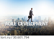 Купить «Agile transformation concept with businessman walking on tight r», фото № 30601794, снято 2 июня 2020 г. (c) Elnur / Фотобанк Лори