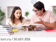 Students preparing for exam together at home. Стоковое фото, фотограф Elnur / Фотобанк Лори