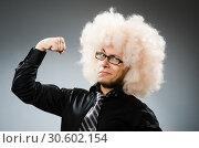 Купить «Young man wearing afro wig», фото № 30602154, снято 15 июня 2014 г. (c) Elnur / Фотобанк Лори