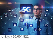 5g internet concept with businessman pressing buttons. Стоковое фото, фотограф Elnur / Фотобанк Лори
