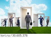 Купить «Businessman in uncertainty concept with many doors», фото № 30605378, снято 18 июня 2019 г. (c) Elnur / Фотобанк Лори
