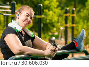 Купить «flexible plus size woman engaged with a port on the playground in a park on a summer morning», фото № 30606030, снято 20 августа 2018 г. (c) Константин Лабунский / Фотобанк Лори