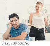 Купить «Frustrated guy at table with dissatisfied girlfriend», фото № 30606790, снято 23 мая 2019 г. (c) Яков Филимонов / Фотобанк Лори