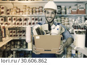 Купить «Workman holding basket with picked tools in paint store», фото № 30606862, снято 13 сентября 2017 г. (c) Яков Филимонов / Фотобанк Лори