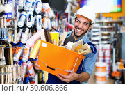 Купить «Workman holding basket with picked tools in paint store», фото № 30606866, снято 13 сентября 2017 г. (c) Яков Филимонов / Фотобанк Лори